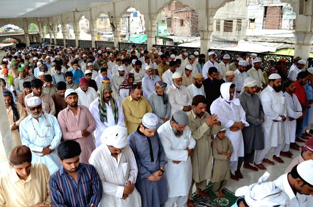 LAHORE, July 1, 2016 - Pakistani Muslims offer Jummat-ul-Vida, the last congregational Friday prayers in the holy month of Ramadan, at the Data Darbar Mosque in eastern Pakistan's Lahore, July 1, ...