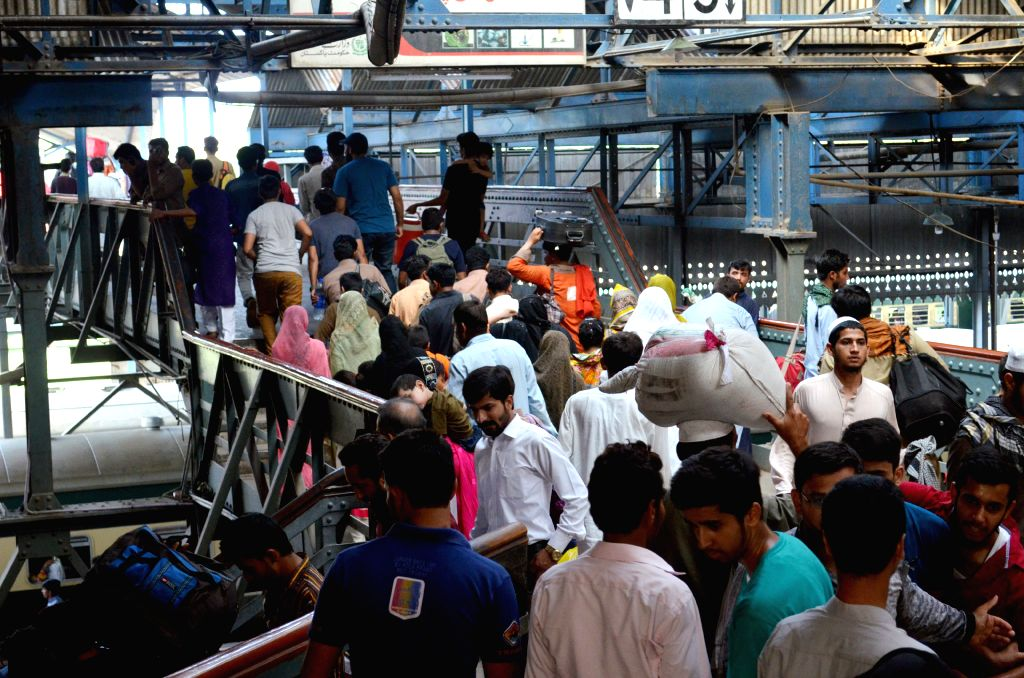 LAHORE, July 10, 2016 - People arrive at a railway station as they return from their hometowns after celebrating Eid al-Fitr festival, in eastern Pakistan' s Lahore, on July 9, 2016.