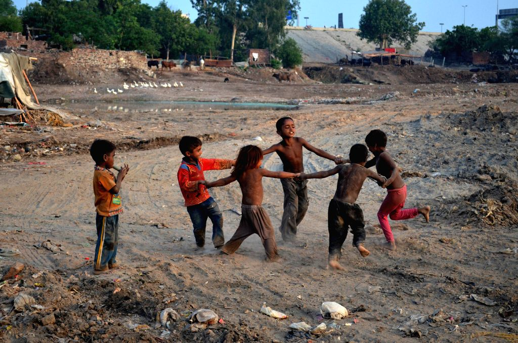 LAHORE, July 11, 2016 - Pakistani children play in eastern Pakistan's Lahore on July 11, 2016.