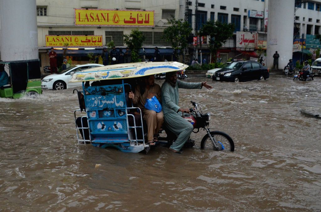 LAHORE, July 16, 2019 - A pedicab moves on a flooded road after heavy monsoon rain in eastern Pakistan's Lahore, on July 16, 2019.