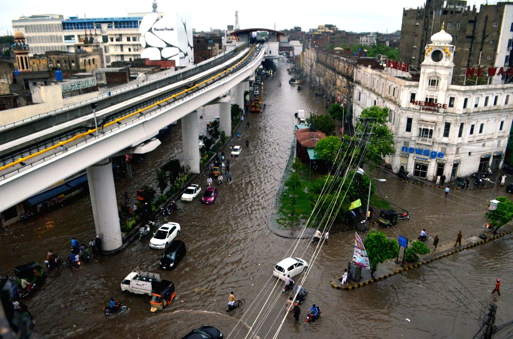 LAHORE, July 16, 2019 - Vehicles move on a flooded road after heavy monsoon rain in eastern Pakistan's Lahore, on July 16, 2019.