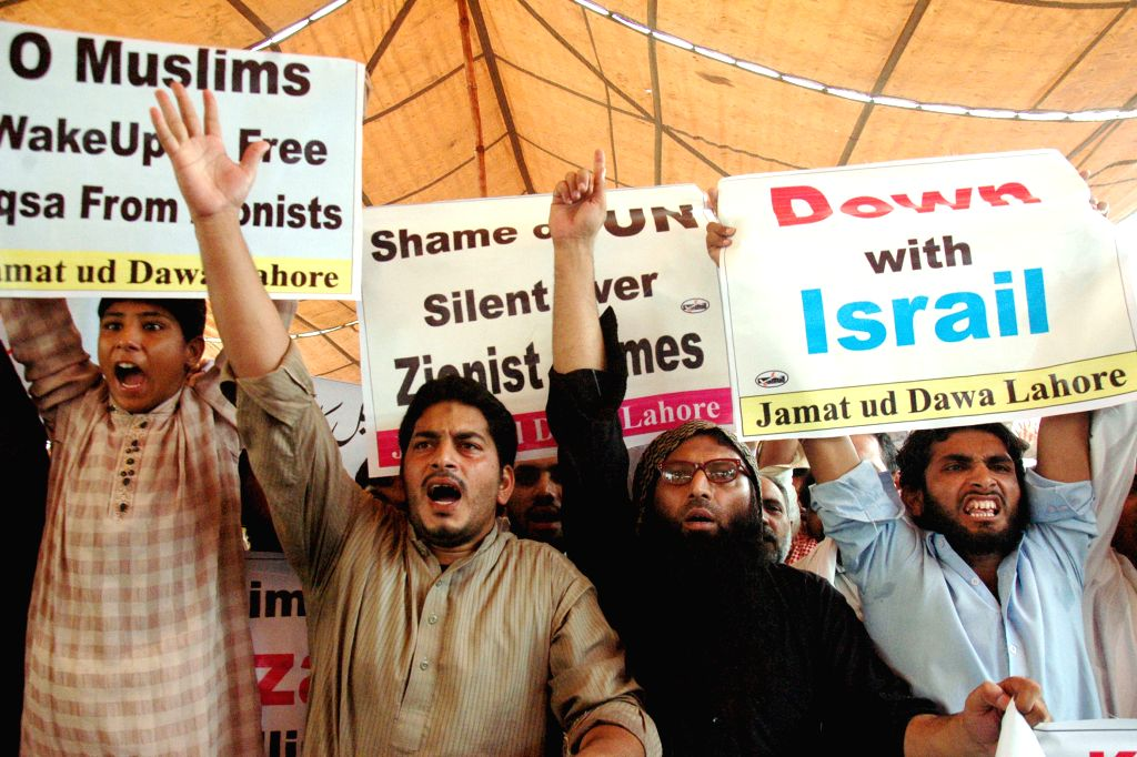 Pakistani Muslims shout slogans during a protest rally against Israeli military strikes on the Gaza Strip that has left over 260 people dead and more than 1,700 ...