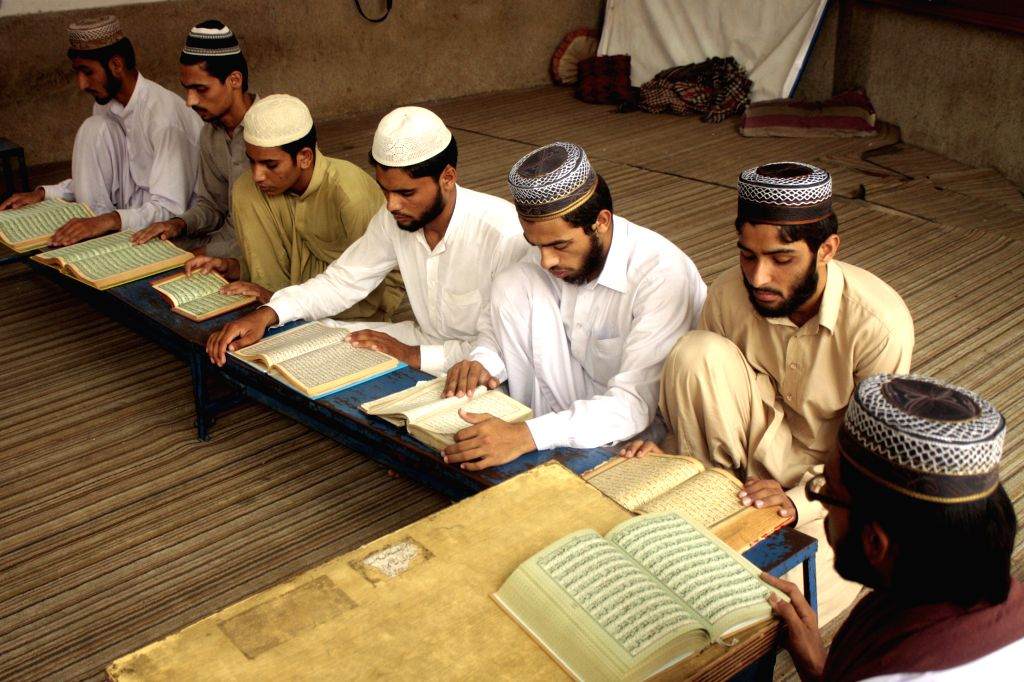 Pakistani people read holy Quran during the holy month of Ramadan in east Pakistan's Lahore on July 3, 2014.