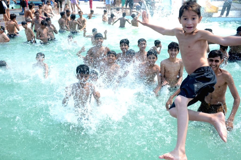 LAHORE, June 1, 2019 - Boys cool off themselves during heat wave in Lahore, Pakistan, June 1, 2019.