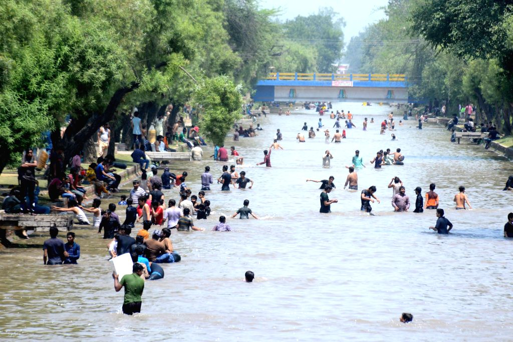 LAHORE, June 1, 2019 - People cool off themselves in water during heat wave in Lahore, Pakistan, June 1, 2019.