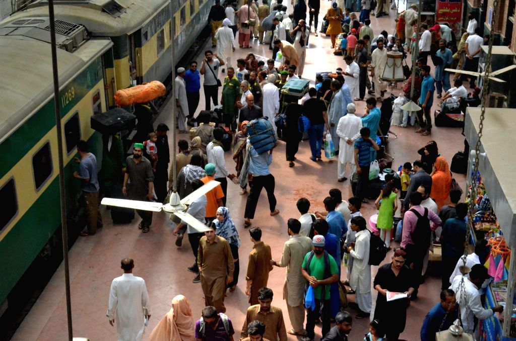 LAHORE, June 14, 2018 - People gather at a platform of a railway station to go back to their hometowns before the Eid al-Fitr festival in Lahore, eastern Pakistan, on June 14, 2018. Muslims around ...