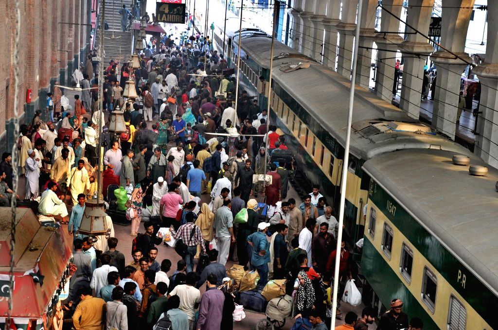 LAHORE, June 24, 2017 - People gather at a railway station to go back to their hometowns before Eid al-Fitr festival in eastern Pakistan's Lahore, on June 24, 2017. Muslims around the world are ...