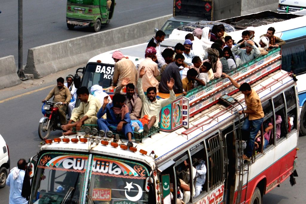 LAHORE, June 24, 2017 - People travel by bus to go back to their hometowns before Eid al-Fitr festival in eastern Pakistan's Lahore, on June 24, 2017. Muslims around the world are preparing to ...