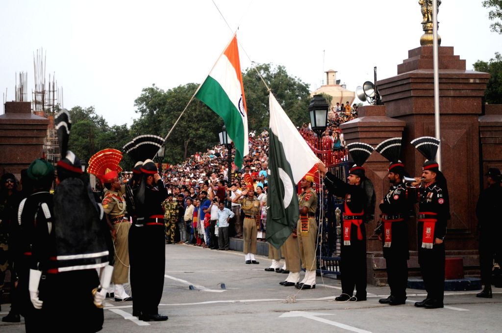 LAHORE, June 26, 2016 - Pakistani Rangers (black uniform) and Indian Border Security Force (BSF) personnel perform the flag off ceremony at the Pakistan-India Wagah Border near eastern Pakistan's ...