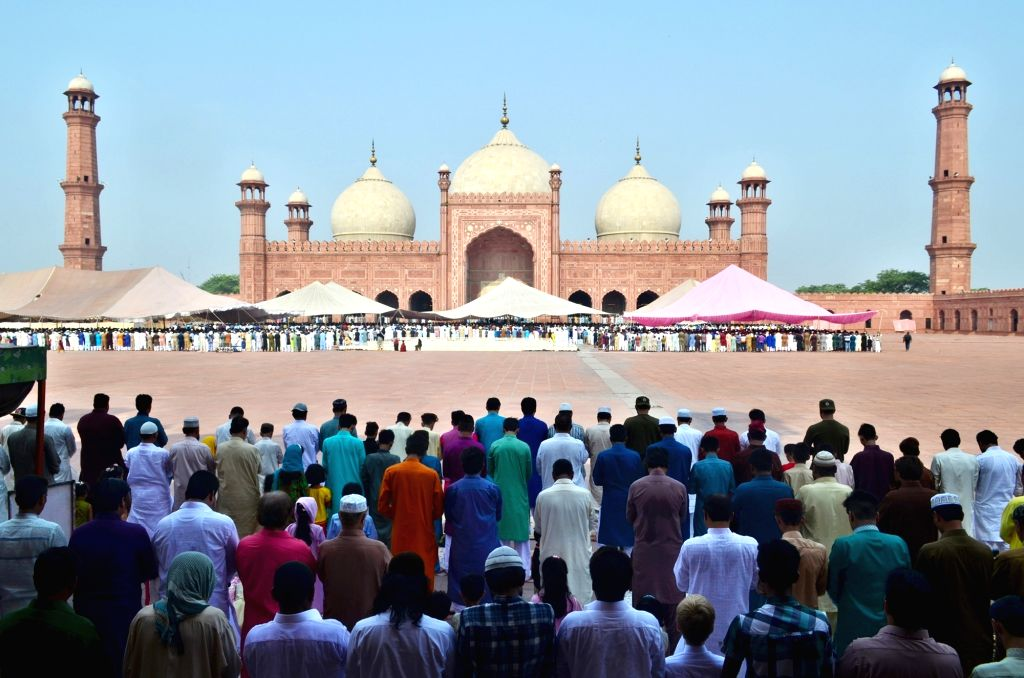 LAHORE, June 26, 2017 - Muslims offer Eid al-Fitr prayers marking the end of the holy fasting month of Ramadan, at Badshahi mosque in eastern Pakistan's Lahore, on June 26, 2017.