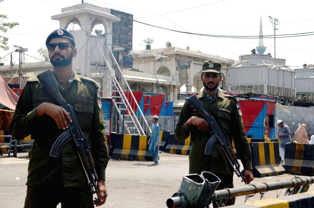 LAHORE, June 3, 2019 - Policemen stand guard outside a mosque ahead of the Eid al-Fitr festival in eastern Pakistan's Lahore, June 3, 2019.