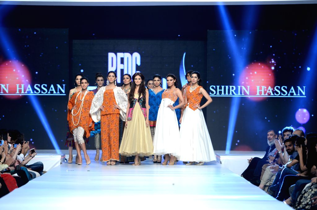Lahore: Models walk the ramp on Day-2 of PFDC Sunsilk Fashion Week 2015 in Lahore, on April 20, 2015.