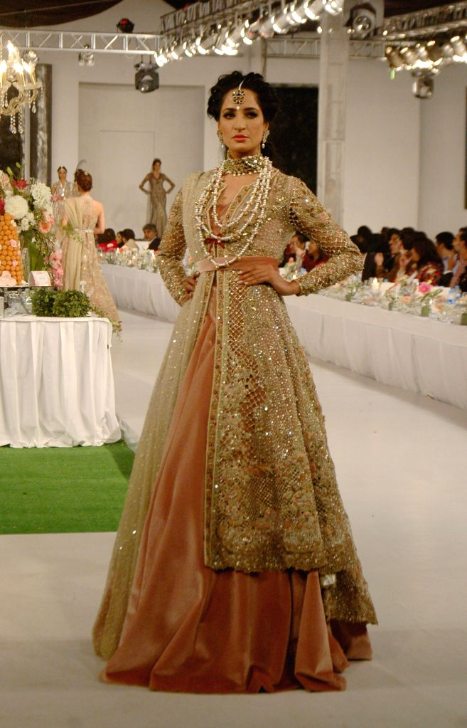 A model presents a creation by designer Aliya Abbas during Pakistan Fashion Designing Council (PFDC) fashion show in eastern Pakistan's Lahore, Feb. 28, 2015. ...