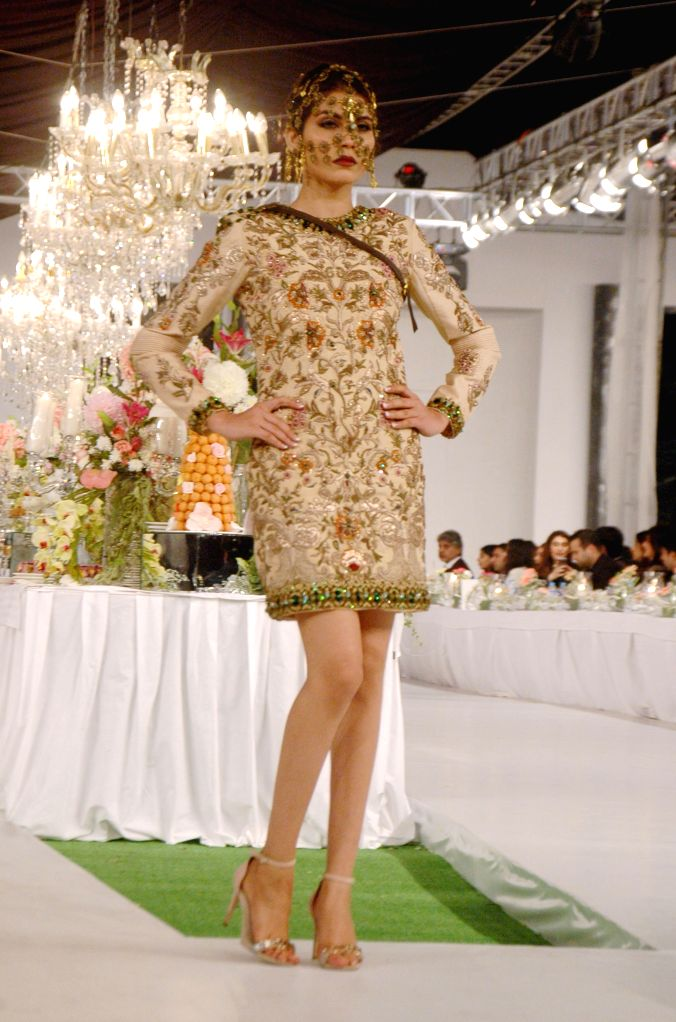 A model presents a creation by designer Hassan Shehriyar during Pakistan Fashion Designing Council (PFDC) fashion show in eastern Pakistan's Lahore, Feb. 28, 2015. ...