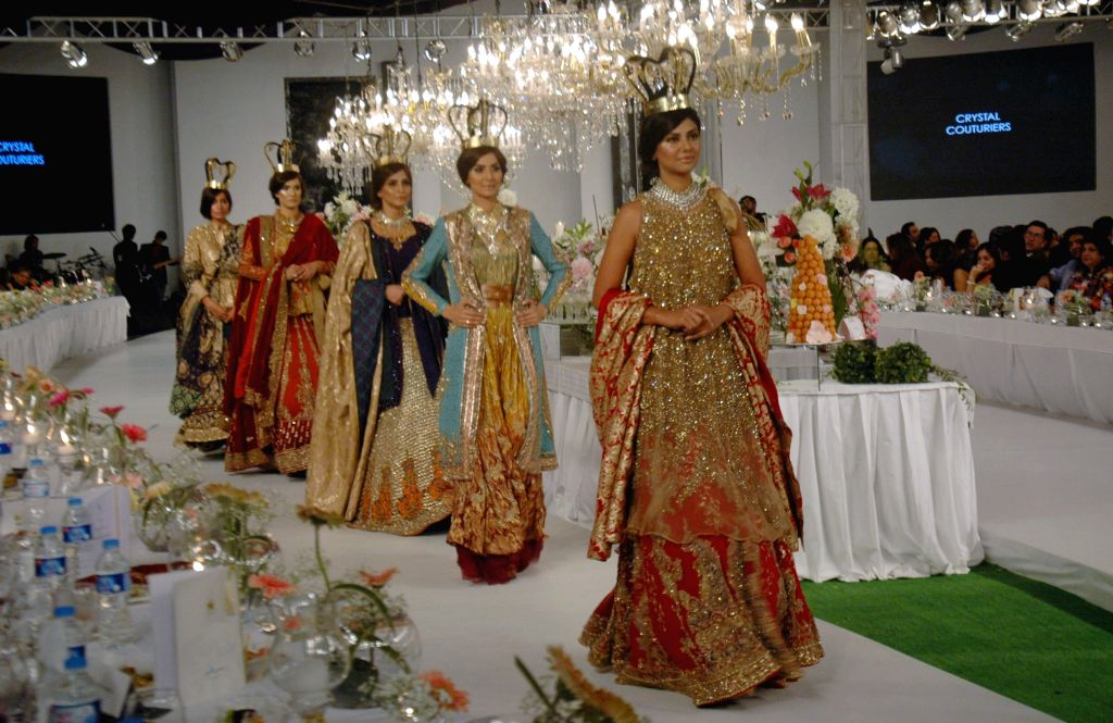 Models present creations by designer Hassan Shehriyar during Pakistan Fashion Designing Council (PFDC) fashion show in eastern Pakistan's Lahore, Feb. 28, 2015. ...