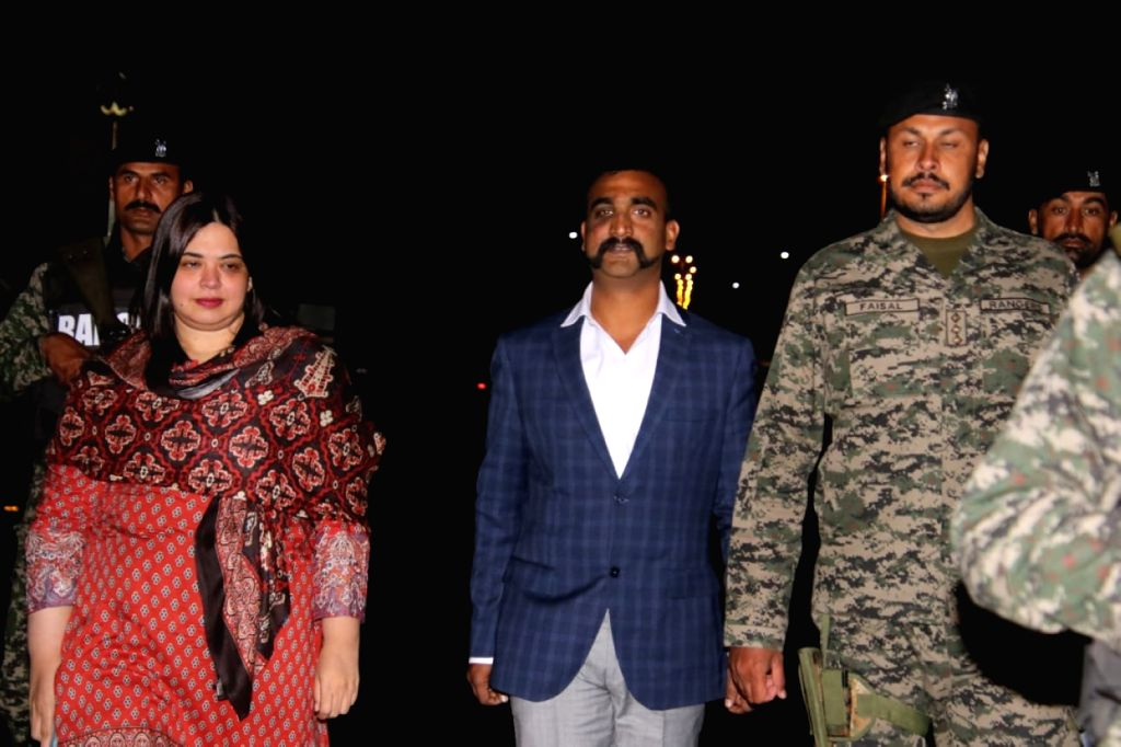 LAHORE, March 1, 2019 - Photo released by Pakistan's Inter-Services Public Relations (ISPR) on March 1, 2019 shows captured Indian pilot Abhinandan Varthaman (C) standing at Wagah border crossing ...