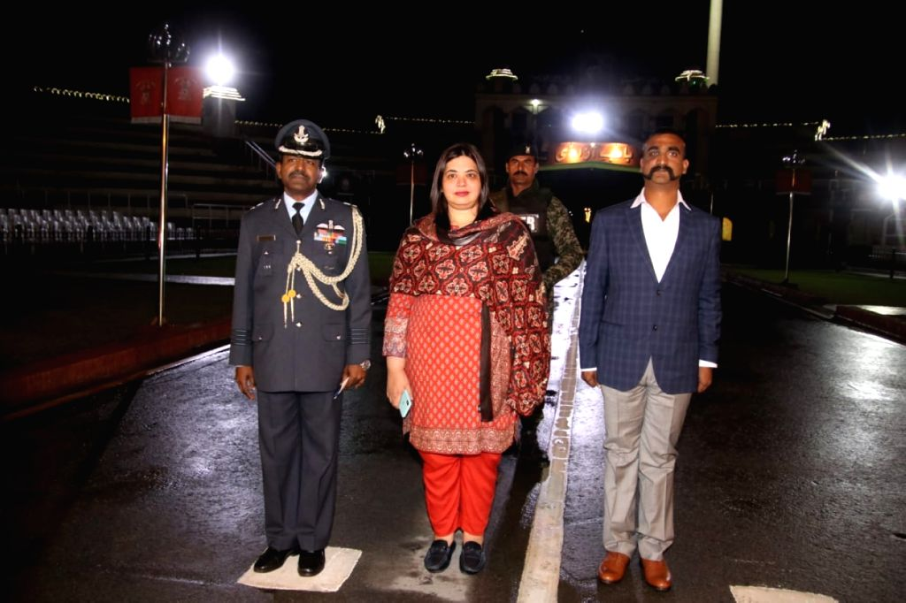 LAHORE, March 1, 2019 - Photo released by Pakistan's Inter-Services Public Relations (ISPR) on March 1, 2019 shows captured Indian pilot Abhinandan Varthaman (R) standing at Wagah border crossing ...