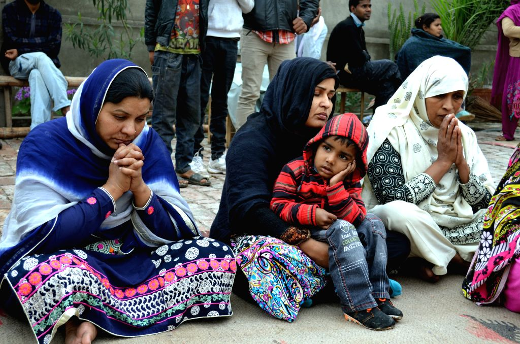 Pakistani Christians attend special prayers against suicide bombing attacks on churches in eastern Pakistan's Lahore, March 16, 2015. At least four people were ...