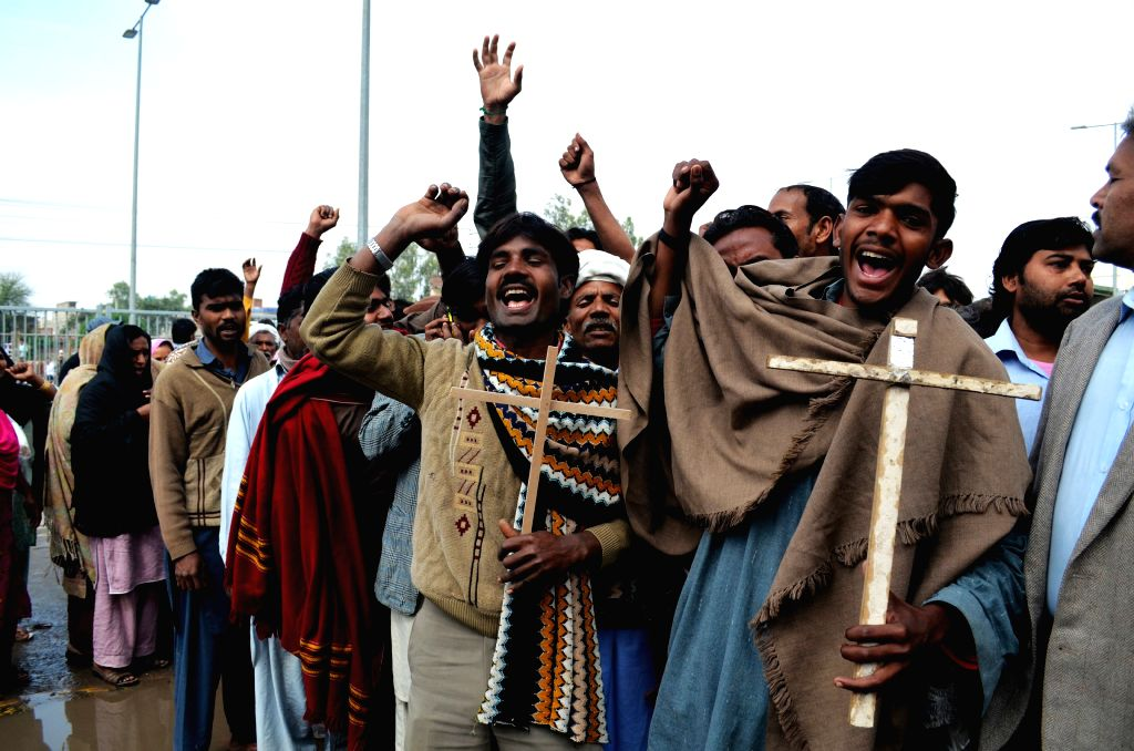 Pakistani Christians protest in eastern Pakistan's Lahore on March 16, 2015, against suicide bombing attacks on churches by Taliban militants. At least 15 people ...