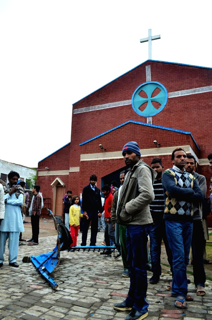Pakistani Christians gather outside a church in eastern Pakistan's Lahore on March 16, 2015, in a protest against suicide bombing attacks on churches by Taliban ...