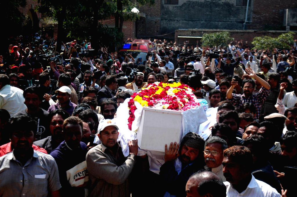 Pakistanis attend a funeral ceremony of church blast victims in eastern Pakistan's Lahore, March 17, 2015. Funeral of the Christians killed in Sunday's attack at ...