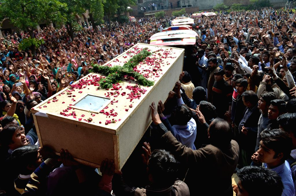 Pakistani Christians attend a funeral of church blast victims in eastern Pakistan's Lahore, March 17, 2015. Funeral of the Christians killed in Sunday's attack at ...