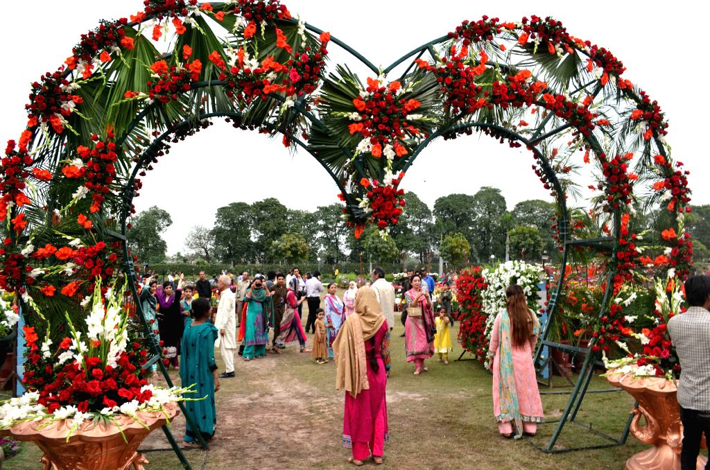 People visit a flower show in eastern Pakistan's Lahore, on March 27, 2015. Flowers are in full blossoms as temperature rises in Pakistan. (Xinhua/Jamil ...