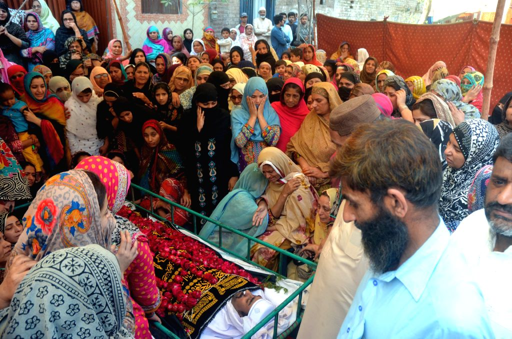 LAHORE, March 28, 2016 - Pakistani people attend a funeral ceremony of a victim following an overnight suicide bombing in eastern Pakistan's Lahore on March 28, 2016. Death toll of the suicide blast ...