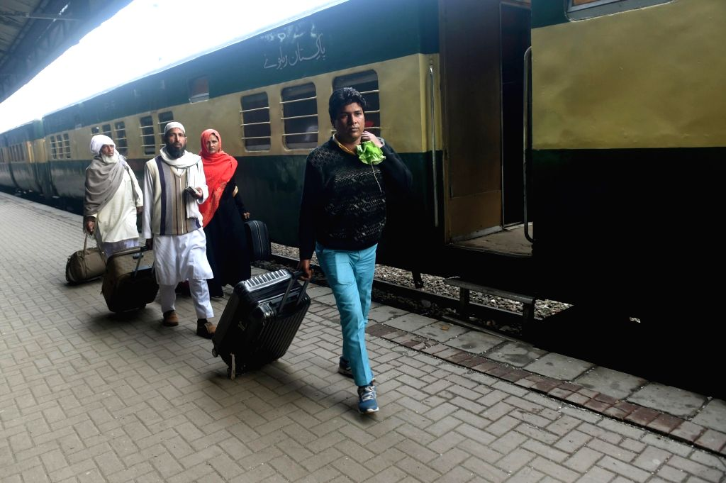 LAHORE, March 5, 2019 - A policeman checks documents of a passenger traveling with the Samjhota Express at a railway station in eastern Pakistan's Lahore on March 4, 2019. A key train service, ...