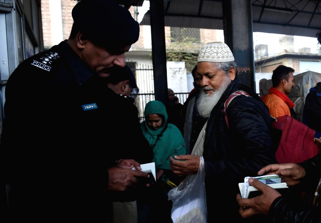 LAHORE, March 5, 2019 (Xinhua) A policeman checks documents of a passenger traveling with the Samjhota Express at a railway station in eastern Pakistan's Lahore on March 4, 2019. A key train service, Samjhauta Express between India and Pakistan, was