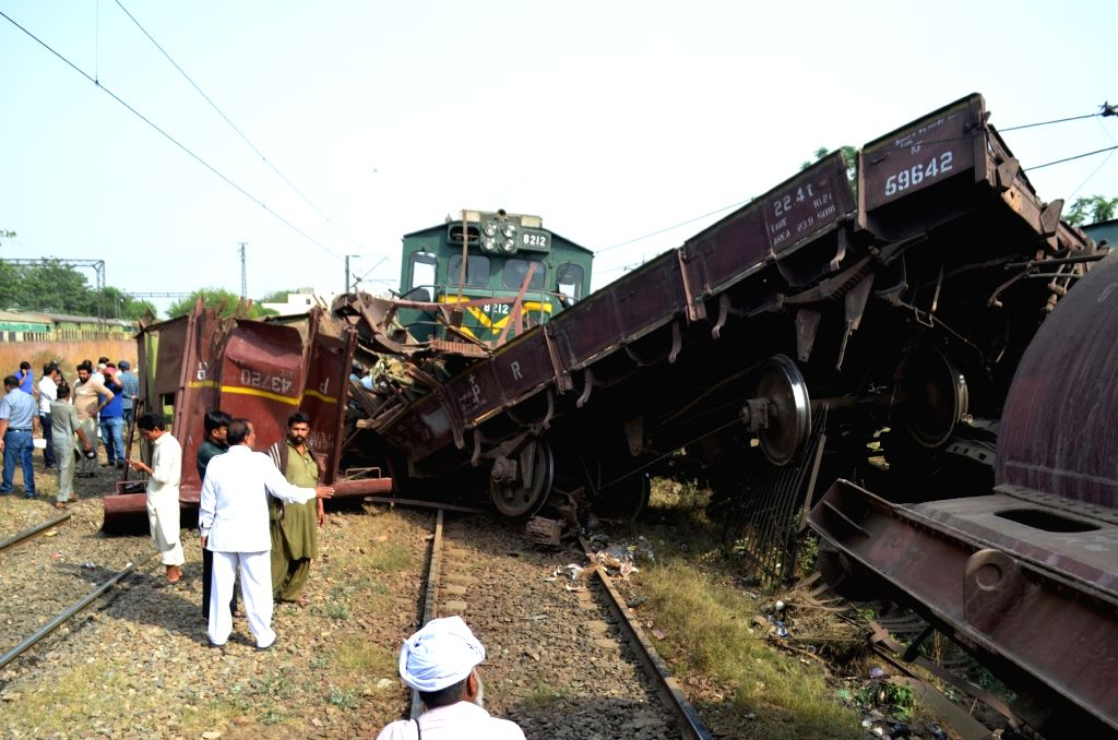 LAHORE, May 23, 2018 - People gather at the accident site in eastern Pakistan's Lahore on May 22, 2018. Two trains were derailed after an accident in Pakistan's eastern city of Lahore on Tuesday ...