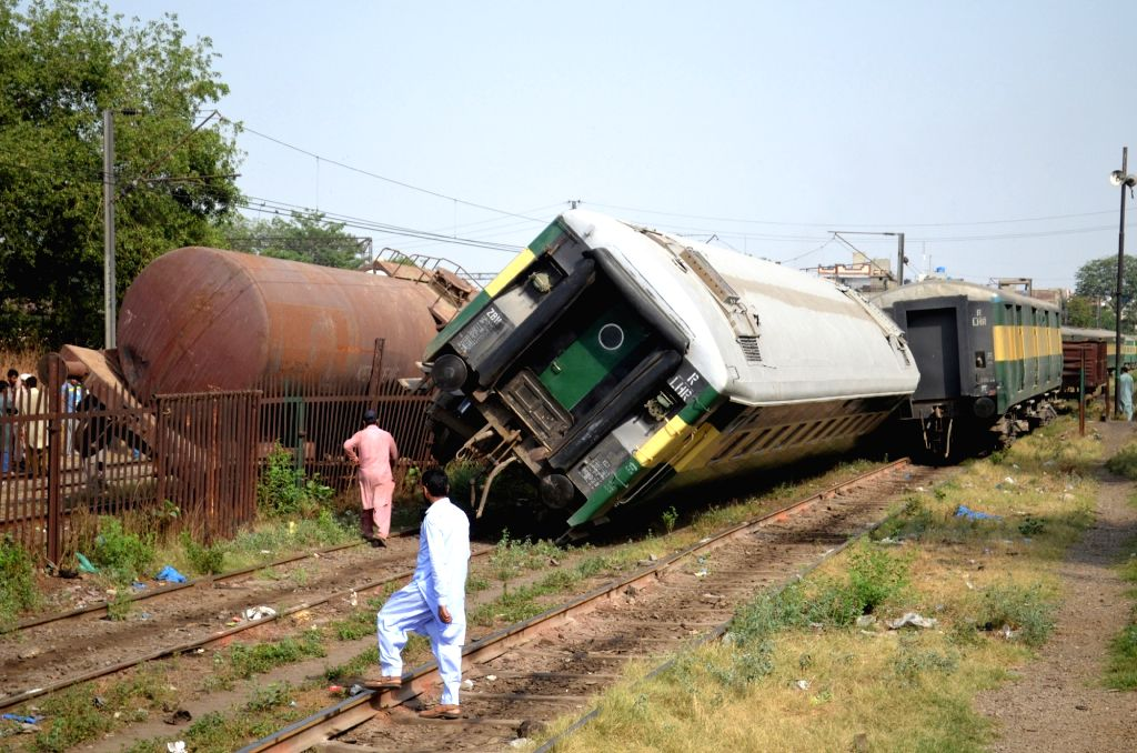 LAHORE, May 23, 2018 - Photo shows an accident site in eastern Pakistan's Lahore on May 22, 2018. Two trains were derailed after an accident in Pakistan's eastern city of Lahore on Tuesday afternoon, ...