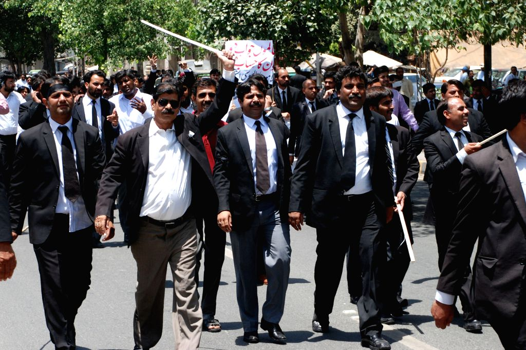 LAHORE, May 26, 2015 (Xinhua) -- Lawyers shout slogans outside Punjab provincial assembly during a protest in eastern Pakistan's Lahore, May 26, 2015. Lawyers in different cities boycott court proceedings and holding demonstrations on Tuesday in prot