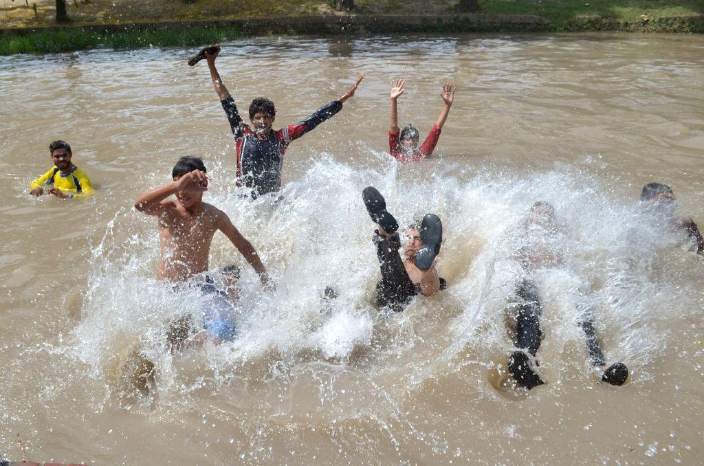 LAHORE, May 27, 2017 - Pakistani youth cool off themselves at a canal as temperature reached 45 degrees Celsius in eastern Pakistan's Lahore, on May 27, 2017.