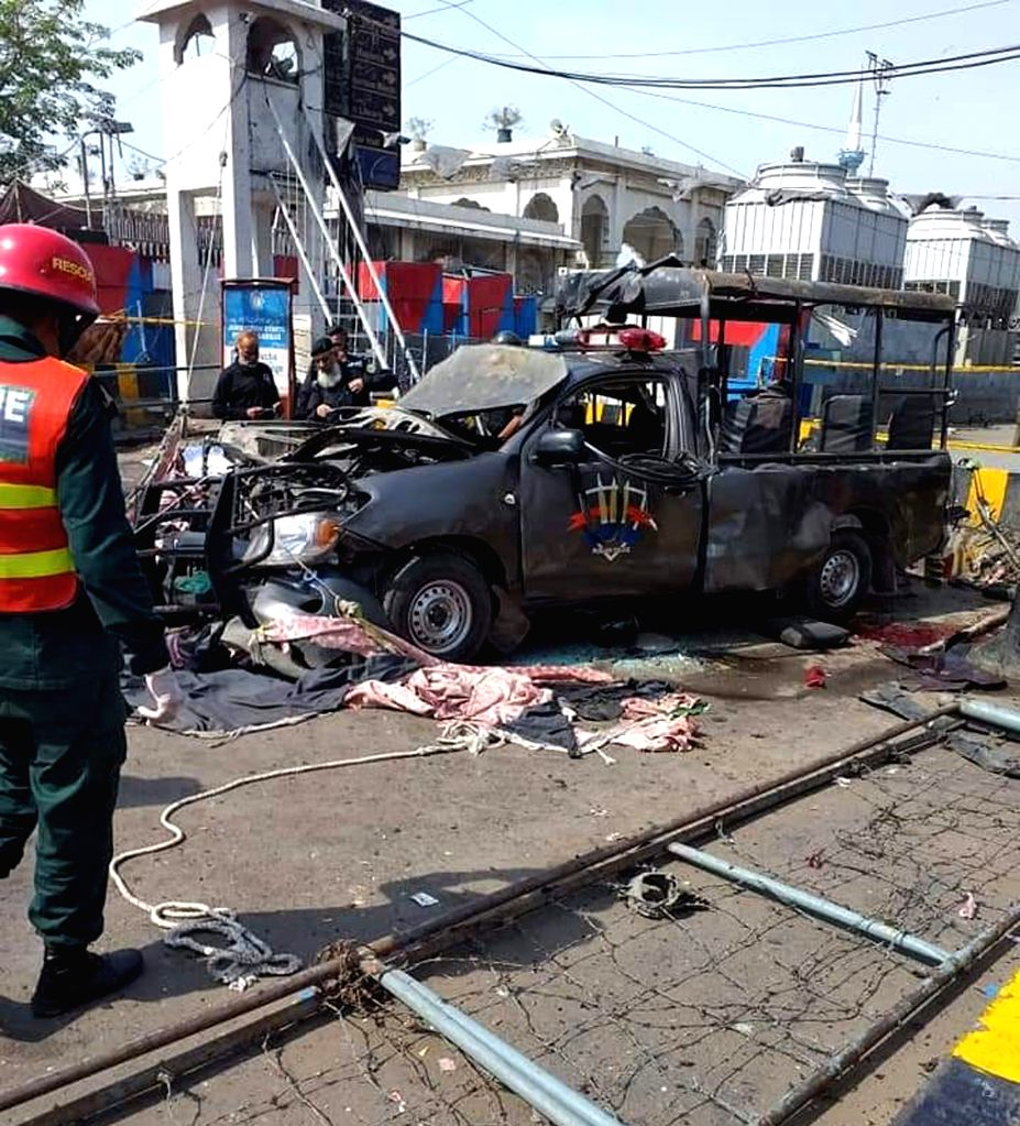 LAHORE, May 8, 2019 (Xinhua) -- A damaged police vehicle is seen at the blast site in Pakistan's eastern city of Lahore on May 8, 2019. At least eight people, including five policemen, were killed and 25 others injured on Wednesday in the suicide att