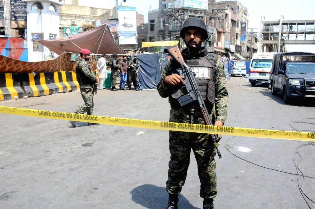 LAHORE, May 8, 2019 (Xinhua) -- Pakistani security personnel stand guard at the blast site in Pakistan's eastern city of Lahore on May 8, 2019. At least eight people, including five policemen, were killed and 25 others injured on Wednesday in the sui
