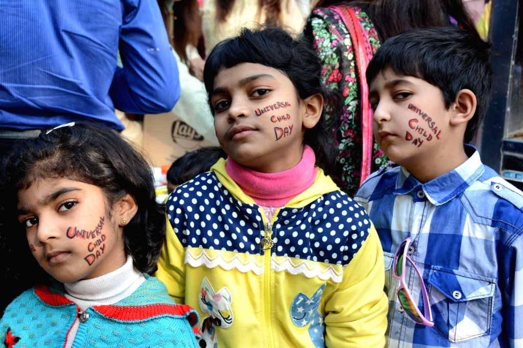 LAHORE, Nov. 19, 2016 - Children pose for a photo on the eve of the Universal Children's Day in eastern Pakistan's Lahore, Nov. 19, 2016. Universal Children's Day, which falls on Nov. 20 every year, ...