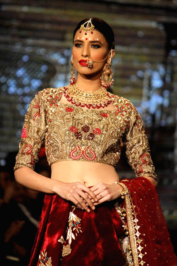 LAHORE, Nov. 26, 2016 - A model presents a creation by designer MNR on the first day of 13th Edition of Bridal Couture Week in eastern Pakistan's Lahore on Nov. 25, 2016.