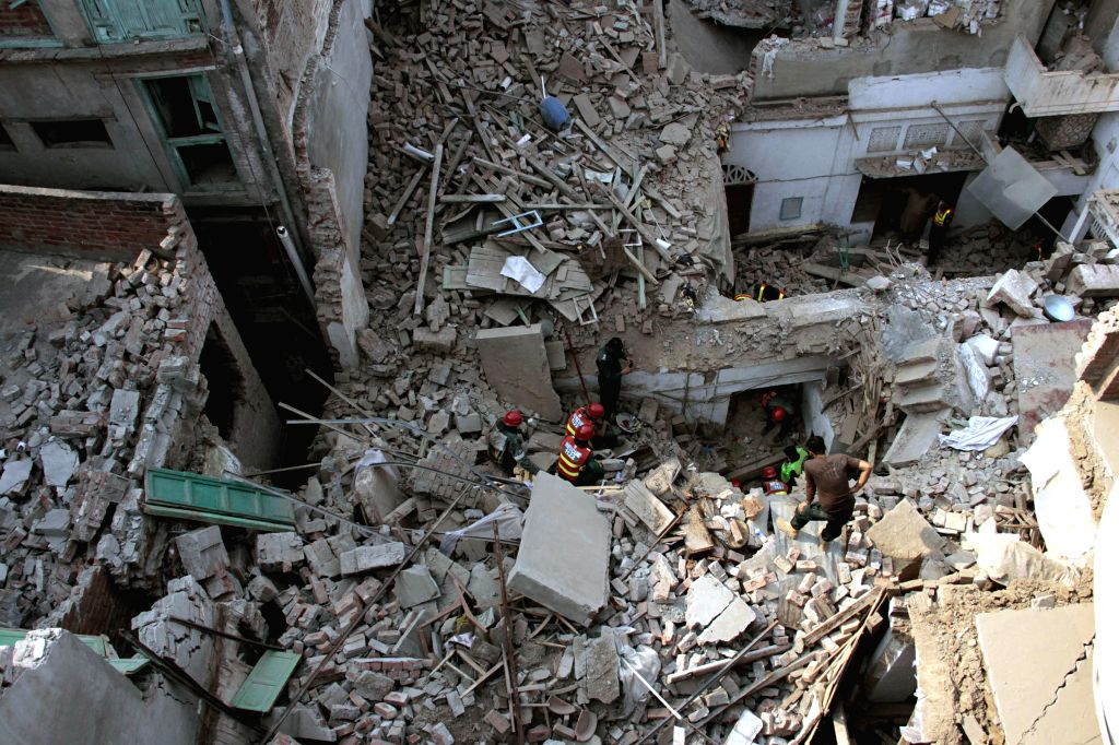 LAHORE, Oct. 26, 2016 - Rescuers take part in a search operation at the building collapsed site in eastern Pakistan's Lahore, Oct. 26, 2016. At least one person was killed and nine others injured ...