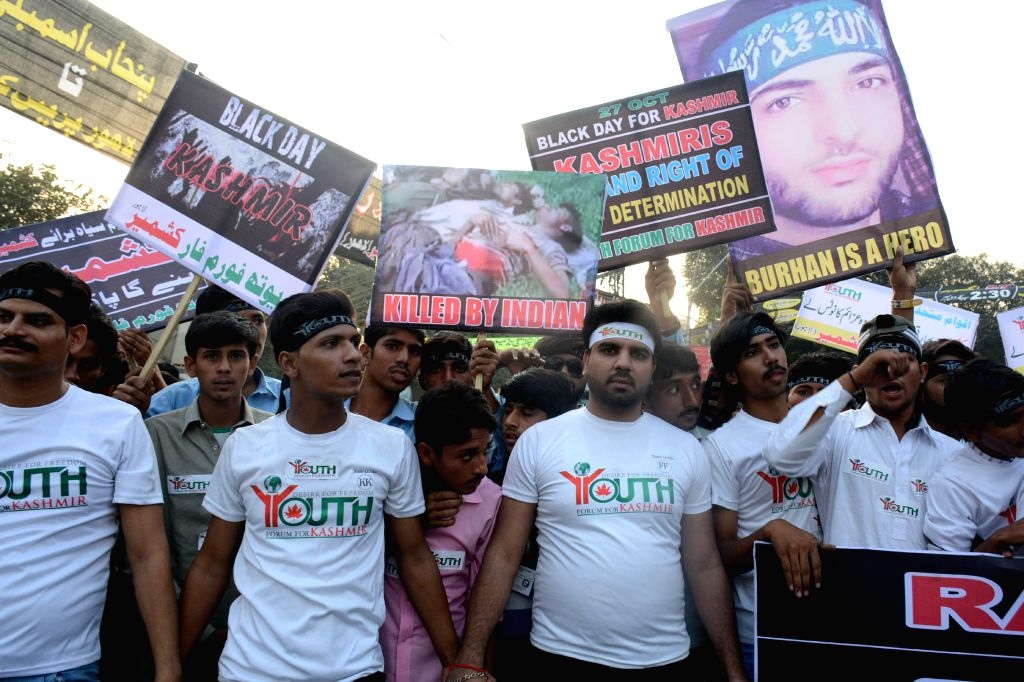 """LAHORE, Oct. 27, 2016 - People attend a protest in eastern Pakistan's Lahore, Oct. 27, 2016. Pakistani protestors observed """"Black Day"""" to express solidarity with people in Indian-controlled ..."""
