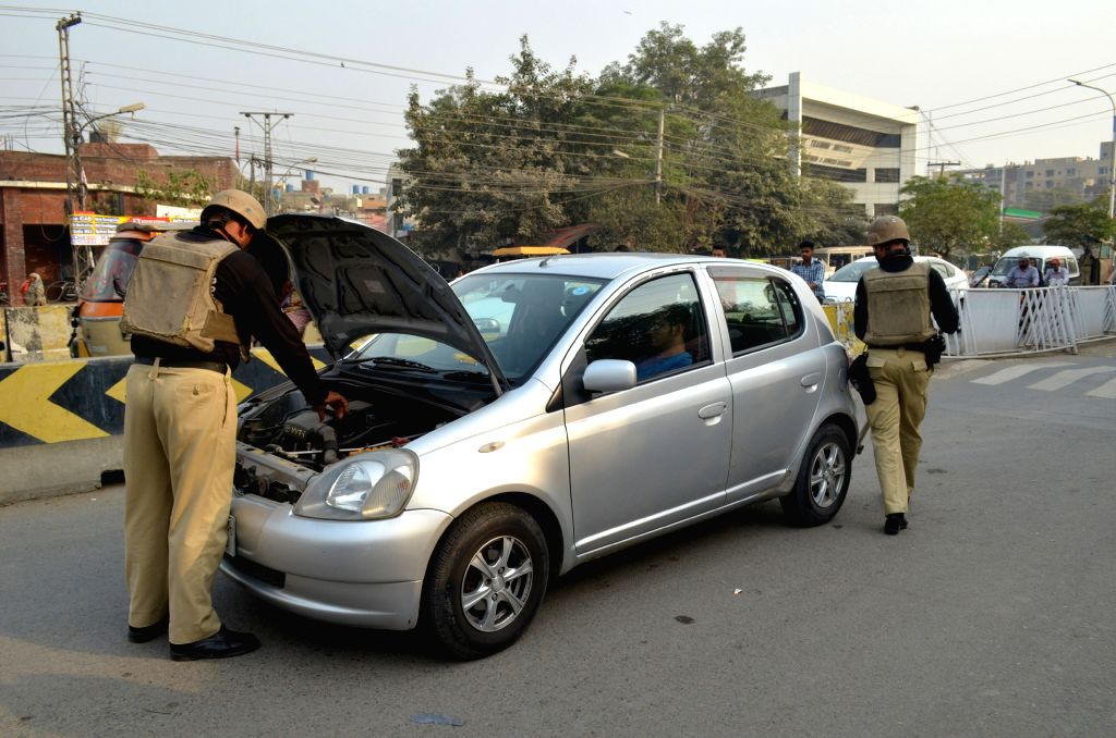 LAHORE, Oct. 29, 2016 - Pakistani policemen check a vehicle due to the security high alert in eastern Pakistan's Lahore, Oct. 29, 2016.