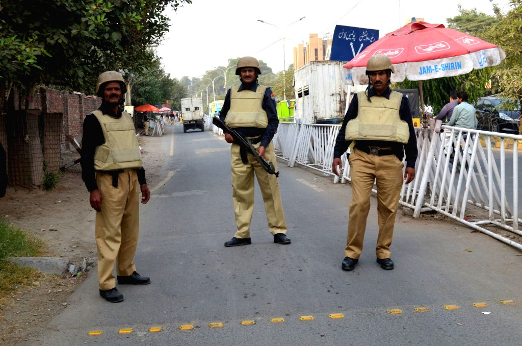 LAHORE, Oct. 29, 2016 - Pakistani policemen stand guard at a check-point due to the security high alert in eastern Pakistan's Lahore, Oct. 29, 2016.