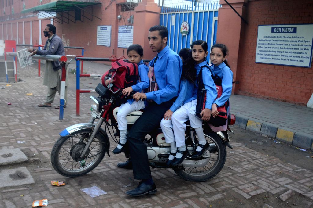 LAHORE (PAKISTAN), Nov. 15, 2019 A man is ready to take students to leave their school which was closed down due to the heavy air pollution in Lahore, eastern Pakistan, on Nov. 15, 2019. ...