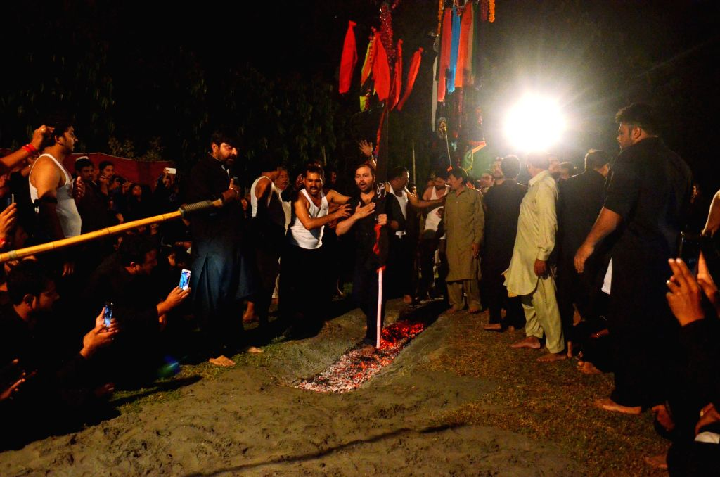 LAHORE(PAKISTAN), Oct. 10, 2016 A Pakistani Shiite Muslim walks on hot coals during a Muharram procession in eastern Pakistan's Lahore, Oct. 10, 2016. The Islamic month of Muharram marks ...