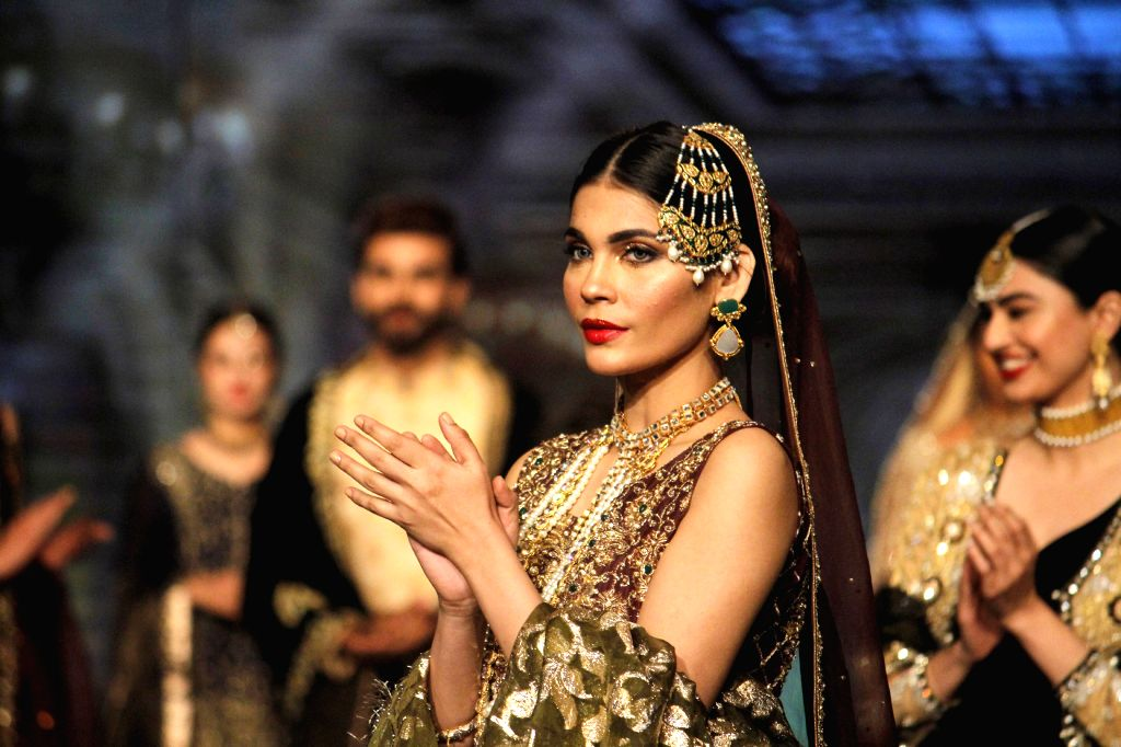 LAHORE (PAKSITAN), Nov. 25, 2016 Models present creations by designer Zonia Anwaar on the first day of the 13th Edition of Bridal Couture Week in eastern Pakistan's Lahore, on Nov. 25, ...