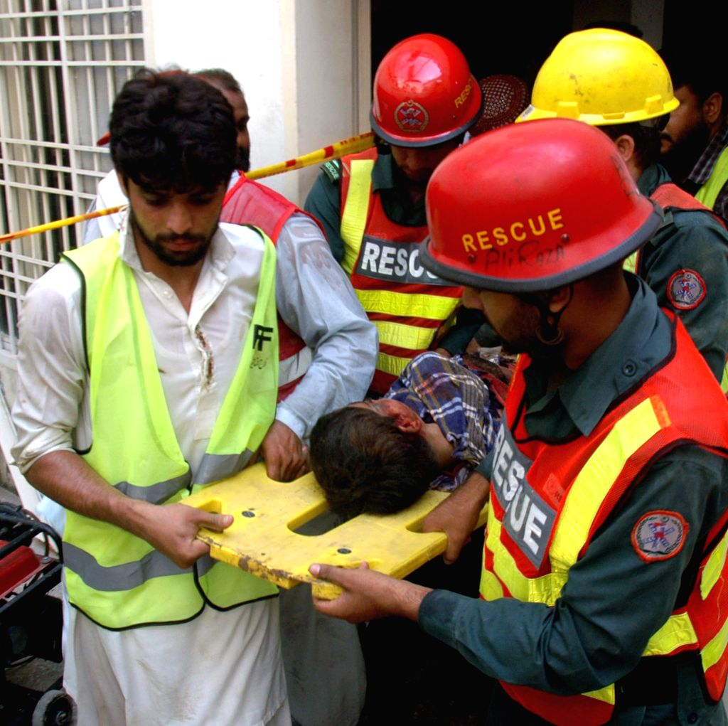 Rescuers work at the collapsed mosque in east Pakistan's Lahore on Sept. 9, 2014. At least 24 people were killed and several others trapped when the roof of a ...