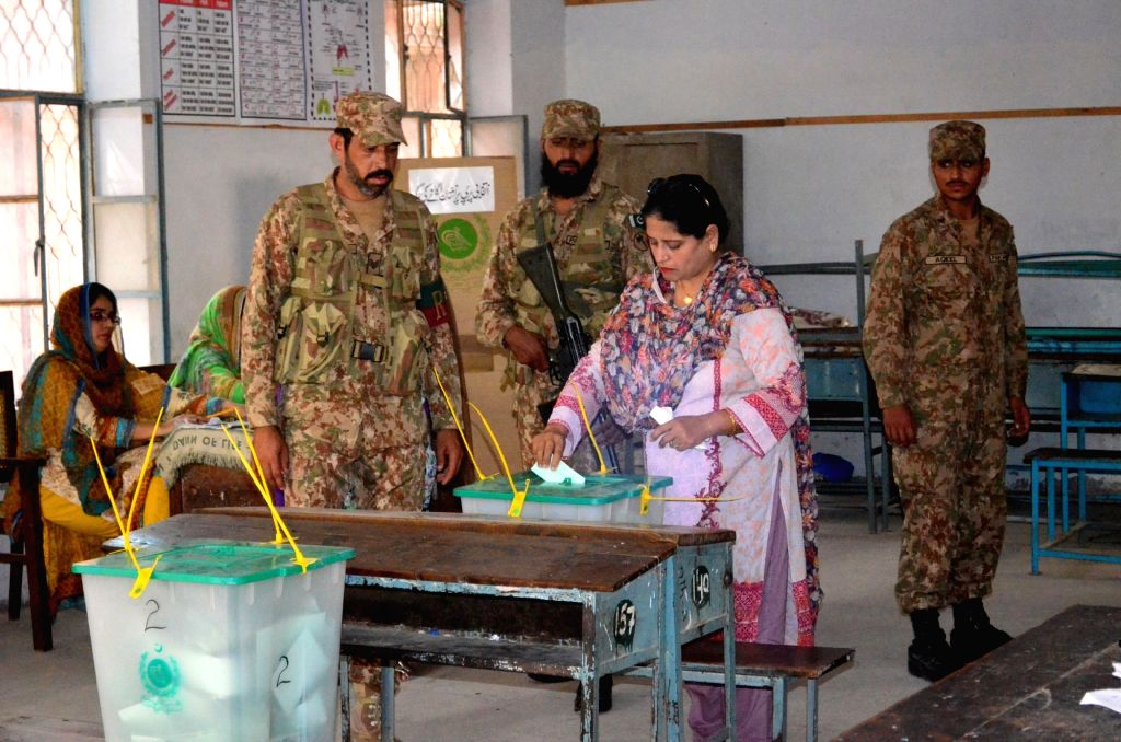 LAHORE, Sept. 18, 2017 - A woman casts her vote during the parliamentary by-election in eastern Pakistan's Lahore, on Sept. 17, 2017. Ousted Pakistani Prime Minister Nawaz Sharif's wife Kulsoom Nawaz ... - Nawaz Shari