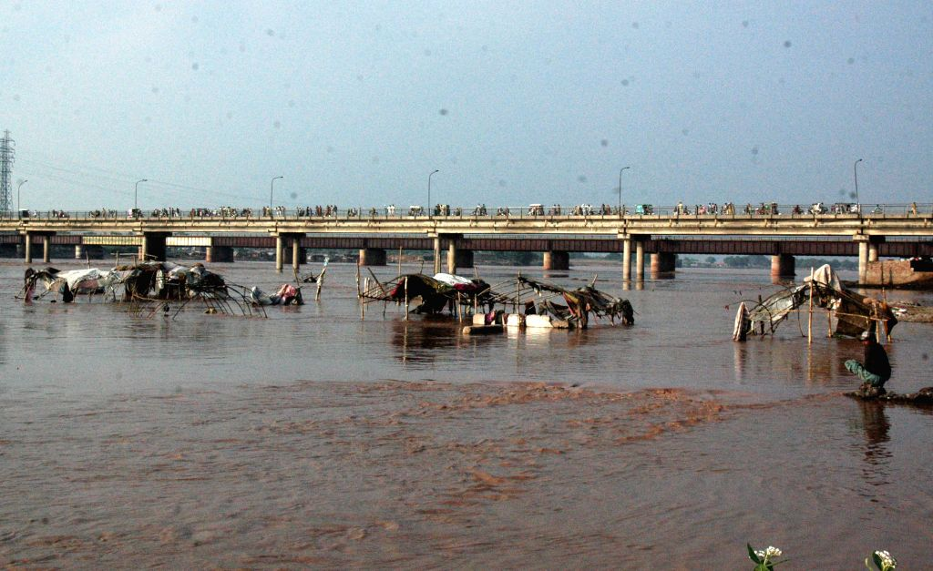 Makeshift tents are seen on the high land of the flooded Ravi River in east Pakistan's Lahore, Sept. 8, 2014. At least 165 people were killed and over 200 others ...