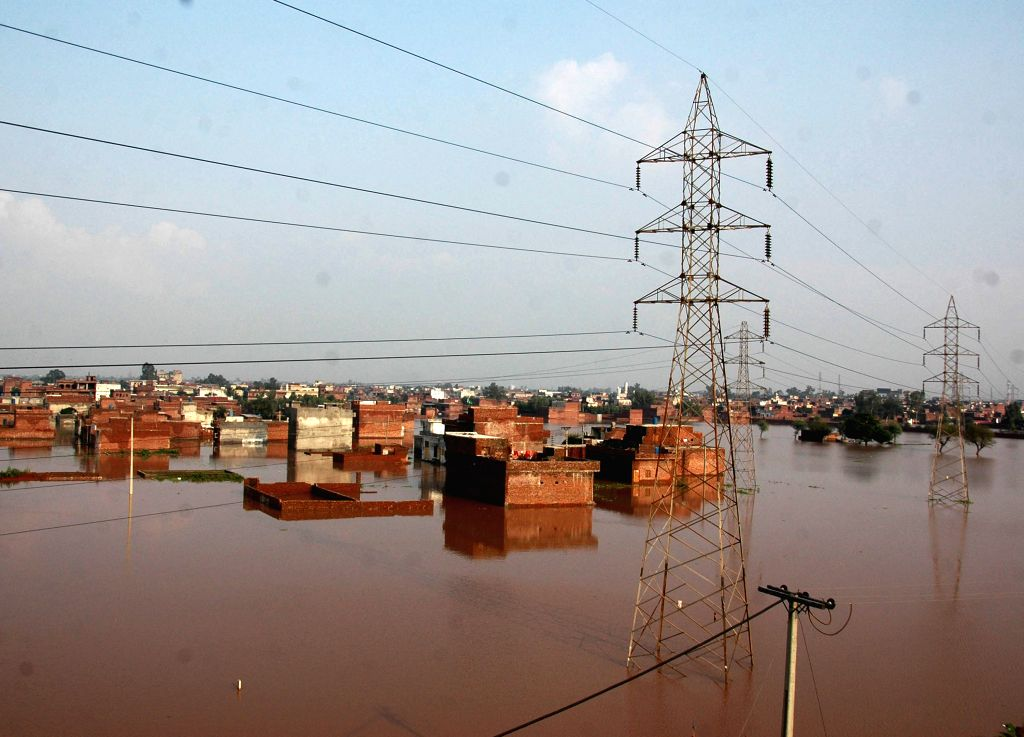 Houses are partially submerged in floodwaters in flood-hit area near east Pakistan's Lahore, Sept. 9, 2014. At least 203 people have been killed and hundreds others .