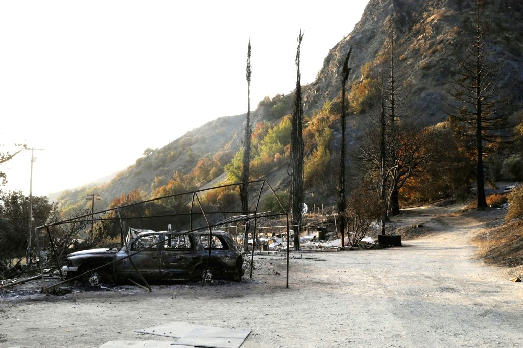 LAKE COUNTY, Aug. 11, 2018 - A wreckage of a car is seen after being burned by a wildfire that swept through Lake county, California, the United States, on Aug. 9, 2018.
